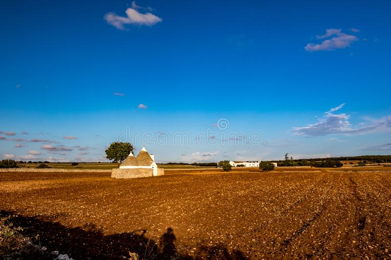 Typical truli architecture, Puglia. Italy. Landscape with typical amazing architecture of truli in the brown soil land in Puglia region, near the town of stock photography