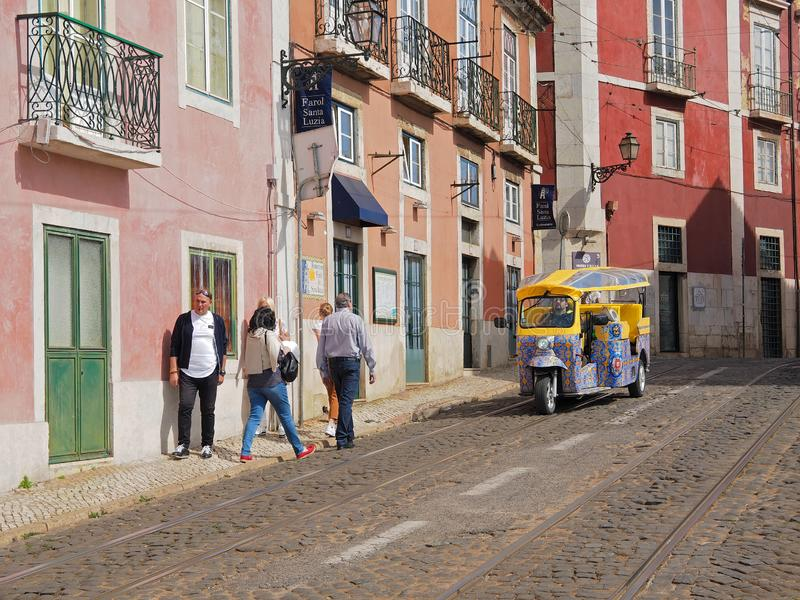 Ride a Tk Tuk in Lisbon stock image
