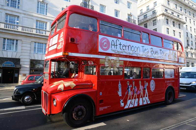Classic London red double decker bus for afternoon tea bus tour royalty free stock images