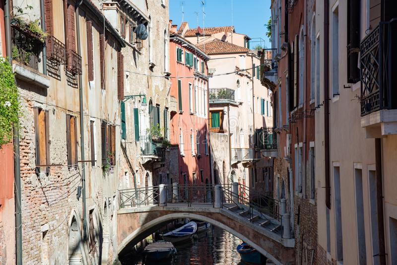Typical Venetian buildings with canal and bridge in Venice, Italy. stock photography