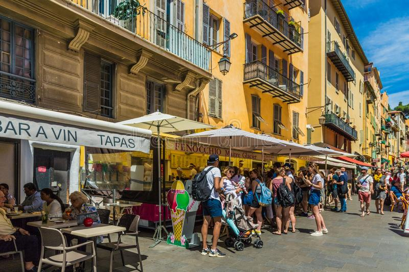A typical view in Nice France. Nice france. June 12 2019. A view of a busy ice cream shop Fenocchio in the old town in Nice France royalty free stock photos
