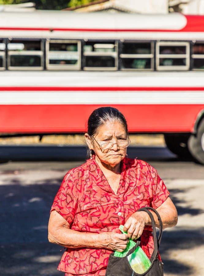 A typical view in San Salvador in El Salvador. San Salvador. February 2018. A local woman in San Salvador in El Salvador stock photo