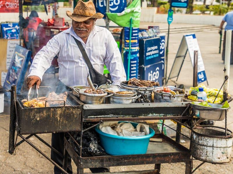 A typical view in San Salvador in El Salvador. San Salvador. February 2018. A bbq stall in San Salvador in El Salvador stock image
