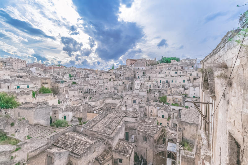 Typical view of stones (Sassi di Matera) of Matera under blue sky. Matera in Italy. UNESCO European Capital of Culture 2019 royalty free stock photos