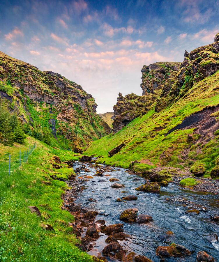 Free Typical Volcano Icelandic Landscape In The Mountains. Sunny Summer Sunrise Of Green Canyon With Pure Water Creeck, South Iceland, Stock Photography - 184690902