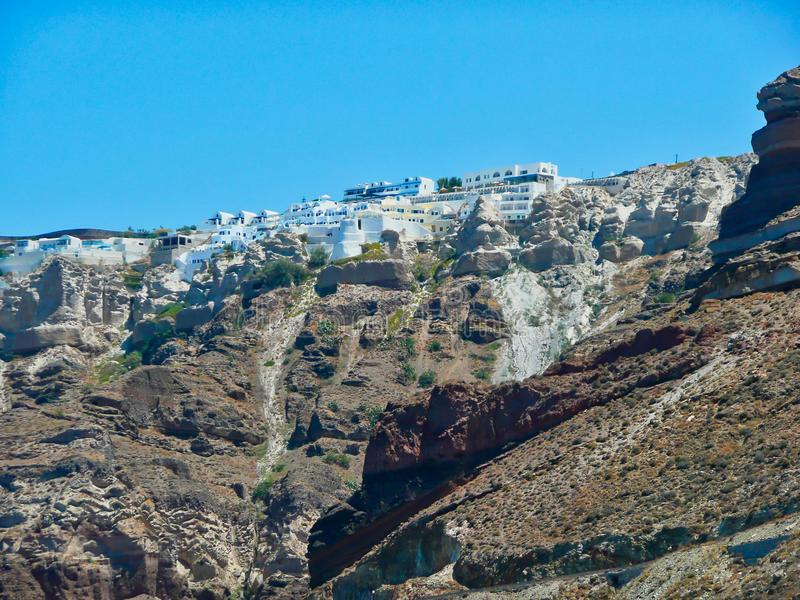 Typical White Cycladic Buildings on Top of Santorini Caldera. Typical white Cycladic architecture buildings on top of the Santorini Caldera, with volcanic ash stock photos