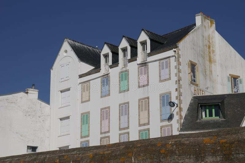 Typical white hotel building with lovely multicolored shutters in Quiberon, closed hotel out of season royalty free stock photo