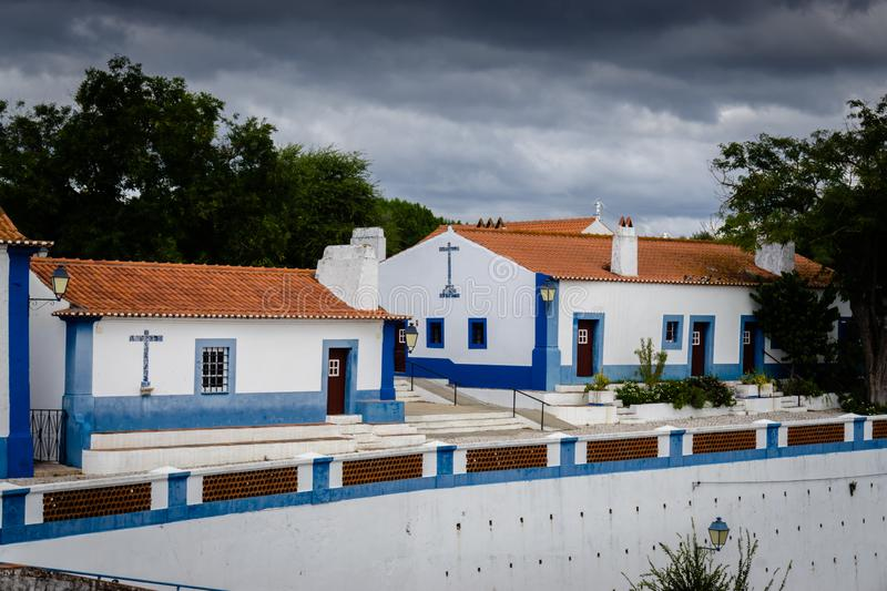 Typical whitewashed terraced cottages in the picturesque historic village of Coruche. Santarem, Ribatejo, Portugal. stock photo