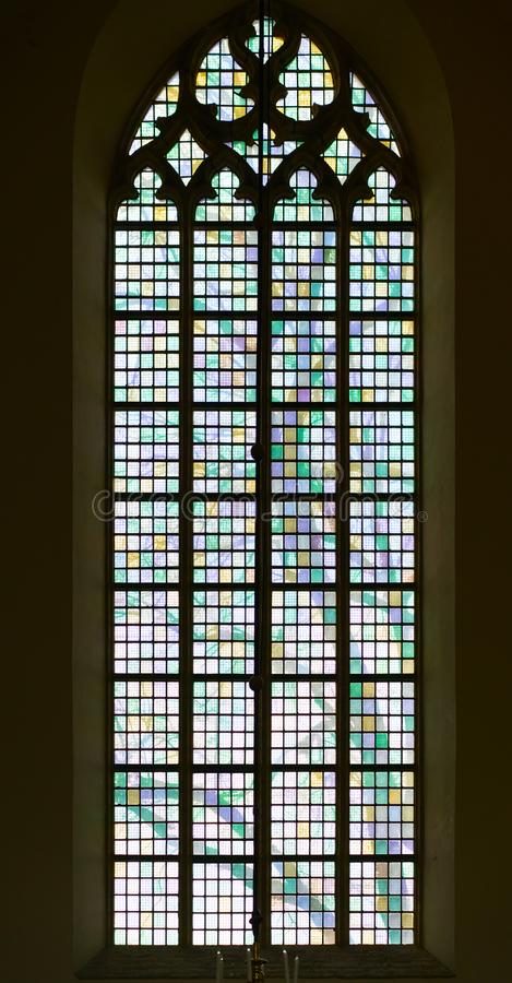 A typical window with colored stained glass in a Protestant church.  royalty free stock photos