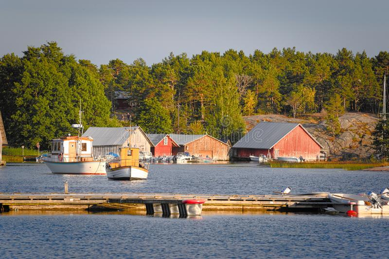 Wooden boathouses at sunset in Aland archipelago, where nature is magnified. Typical wooden boathouses and boats at anchor in the sunset in Aland archipelago stock photos
