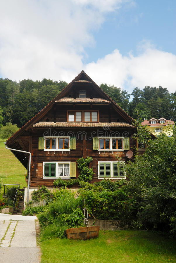 Typical wooden chalets. Typical wooden residential houses in Switzerland royalty free stock photo