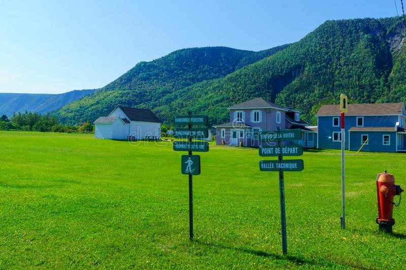 Typical wooden houses and signs in Mont-Saint-Pierre, Gaspe Peninsula stock photography