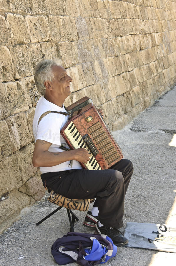 Typically poor Greek musician stock photo