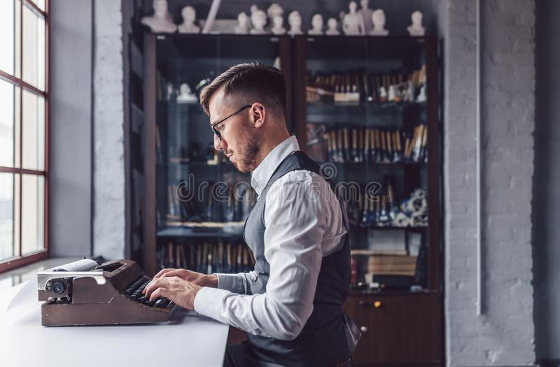 Typing author at work. Typing author in the office royalty free stock photography