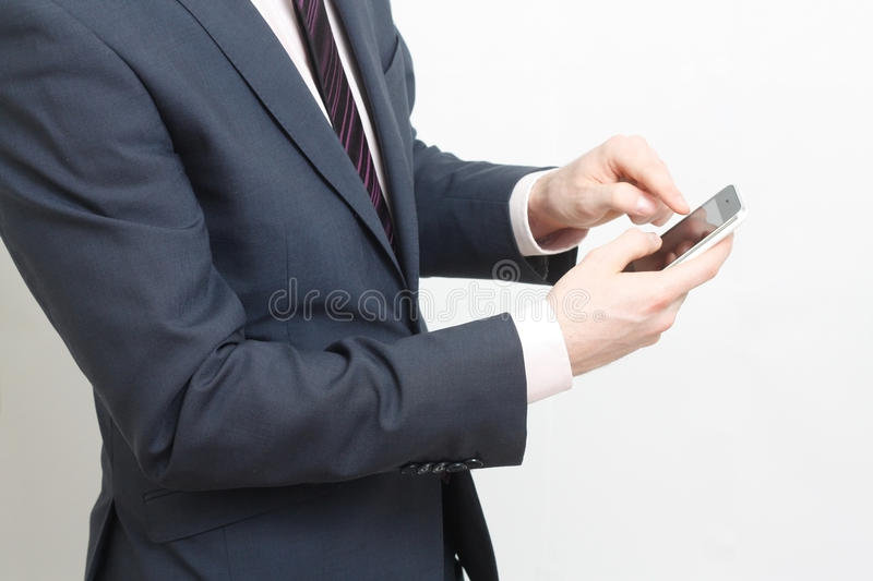 Typing on cell phone royalty free stock image
