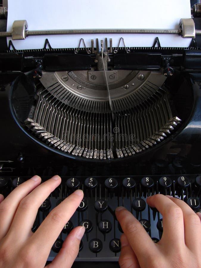 Typing on old typewriter. Hands typing on old typewriter stock photos