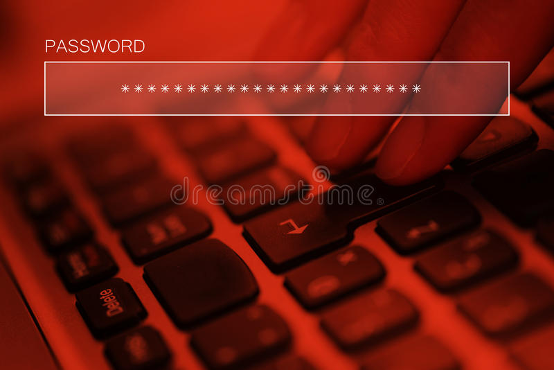 Typing online account password on laptop computer keyboard. Internet security concept stock photography
