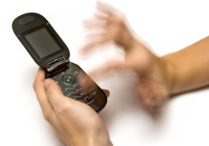 Typing a SMS. On a cell phone stock images