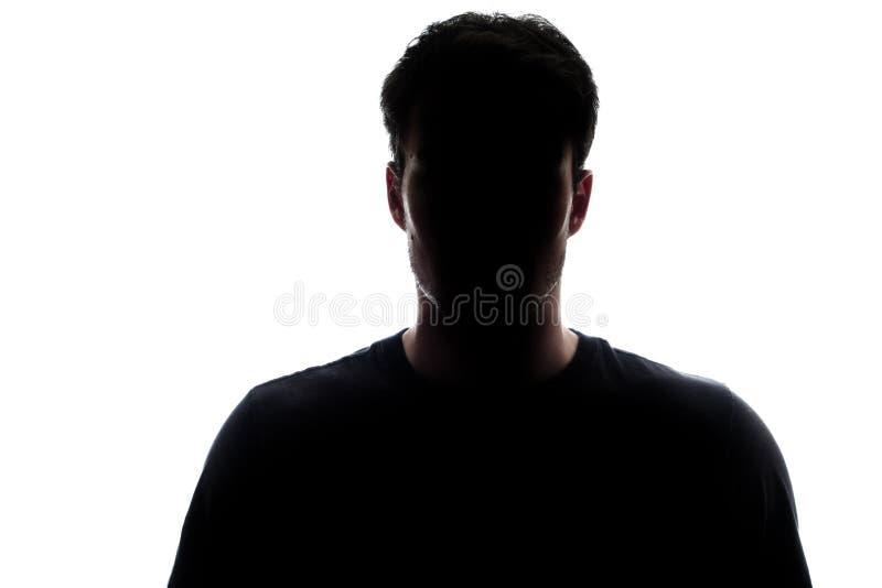 Typisches Mannschattenbild des oberen Körpers, das ein T-Shirt trägt stockbild