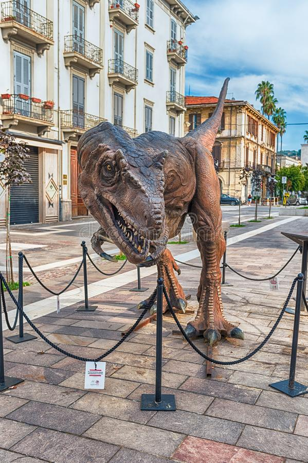 Tyrannosaurus Rex dinosaur, aka t-rex, at exhibition in Cosenza, Italy. COSENZA, ITALY - AUGUST 25: Tyrannosaurus Rex dinosaur featured in the open air stock images