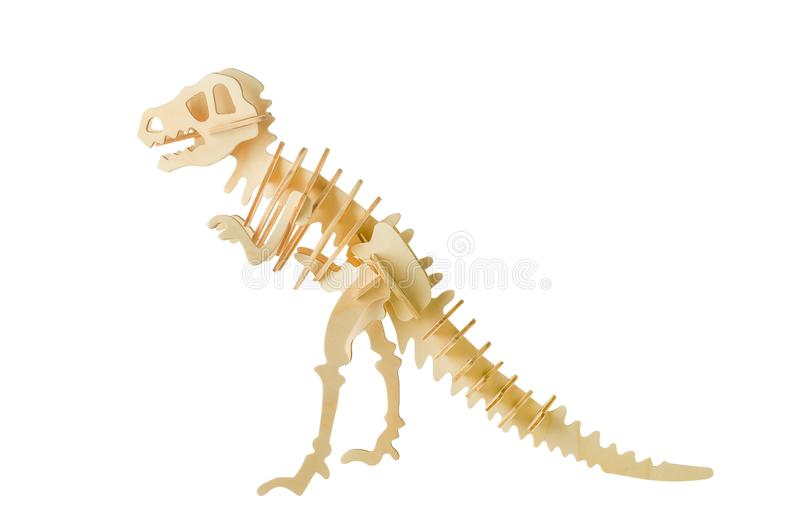 Tyrannosaurus skeleton wooden puzzle toy. Close up of Tyrannosaurus skeleton wooden puzzle toy isolated on white background with clipping path stock photo