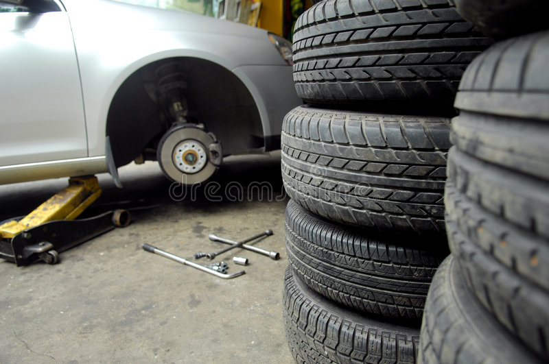 Tyre and car. Car disc break detail with tyre tool and car royalty free stock photo