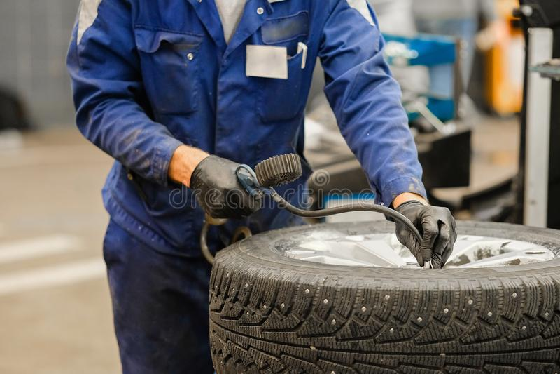 Tyre repair working shop stock image