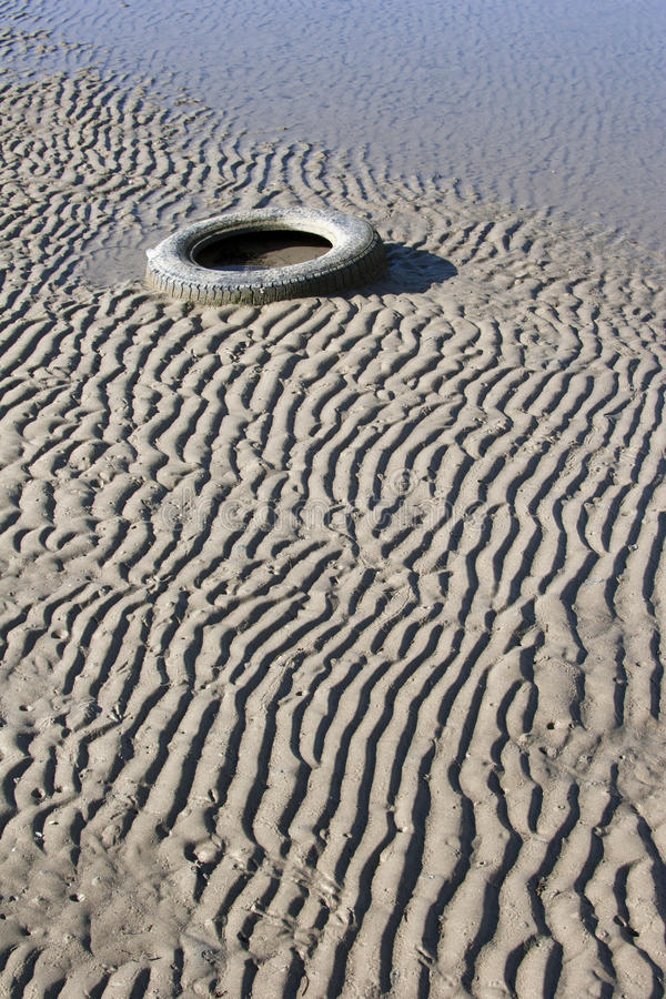 Tyre In The Sand Royalty Free Stock Images