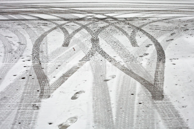 Tyre tracks. Heart shaped tyre tracks in the snow stock photography
