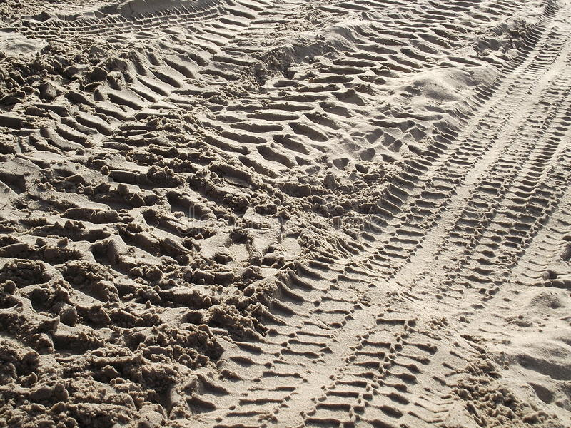 Tyre Tracks in Sea Sand 5. Tyre tracks and Sea sand and beach at the beach on the sand stock photos
