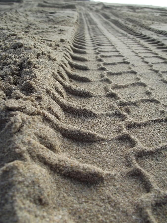 Tyre Tracks in Sea Sand (close up) 3. Tyre tracks and Sea sand and beach at the beach on the sand close up royalty free stock photos