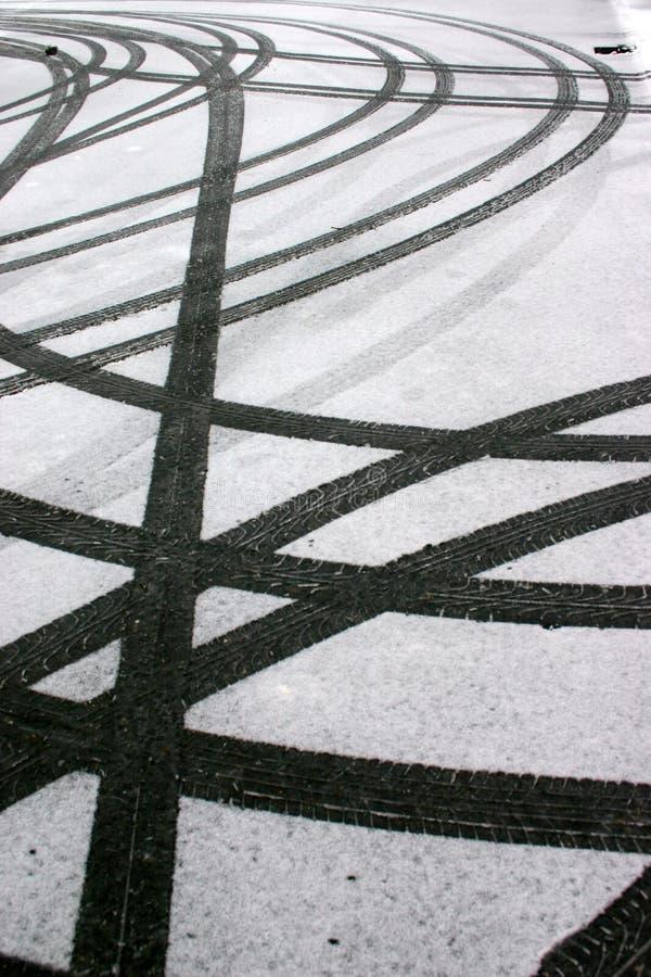 Tyre tracks in snow stock photo