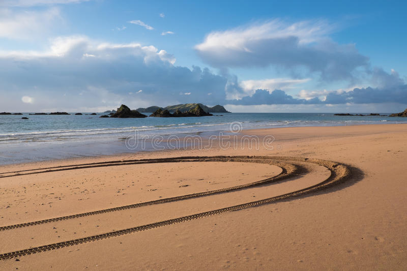 Tyre tracks at Tauranga Bay, Northland, NZ stock photography