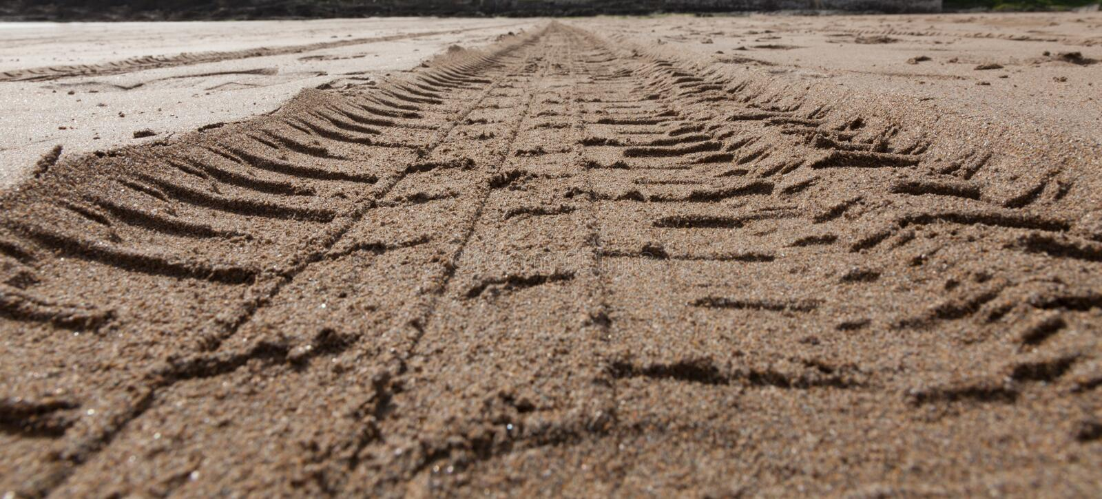 Tyre Treads In The Sand Stock Photos