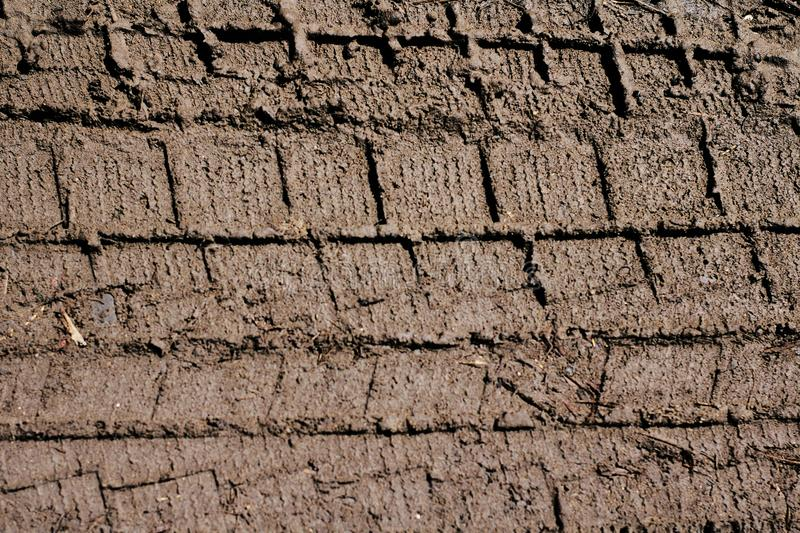 Tyre or wheel track on dirt sand or mud soil background stock photography