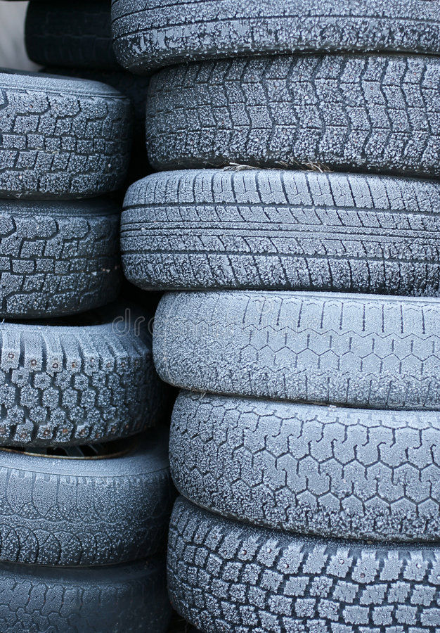 Tyres. A stack of tyres covered in hoar-frost royalty free stock photography