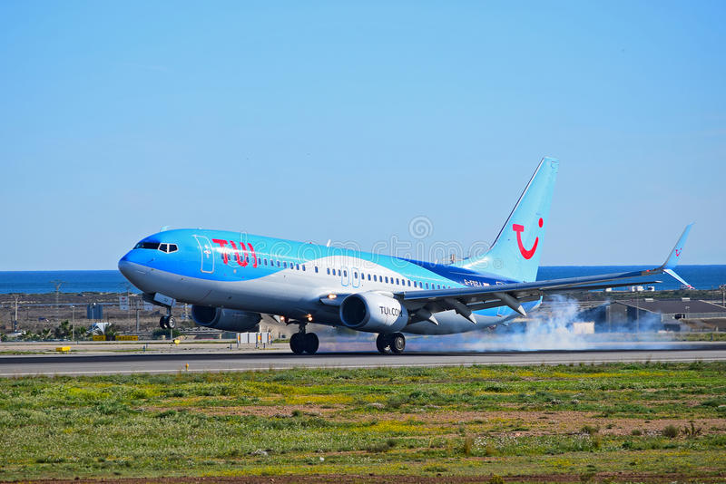 Tyres Smoke As Aircraft Lands. A TUI Thompsons Holiday flight smoking the tyres as it touches down at Alicante Airport stock photography