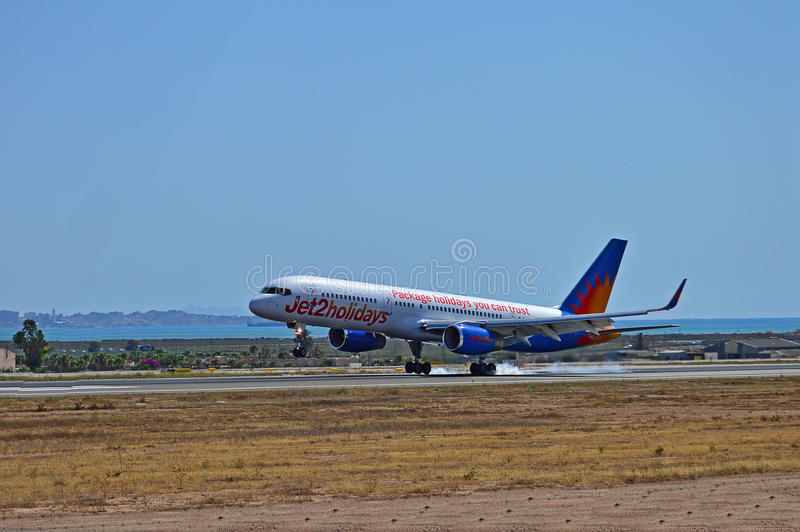 Tyres Smoking On Landing. A Jet2 holidays aircraft smoking its tyres while landing at Alicante Airport in Spain stock photography