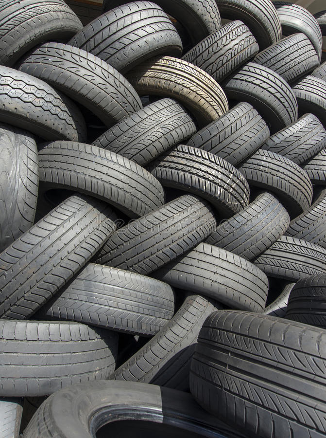 Tyres stacked in a pattern #2. Worn out tyres stacked in a pattern ready for recycling. Copyspace royalty free stock photography