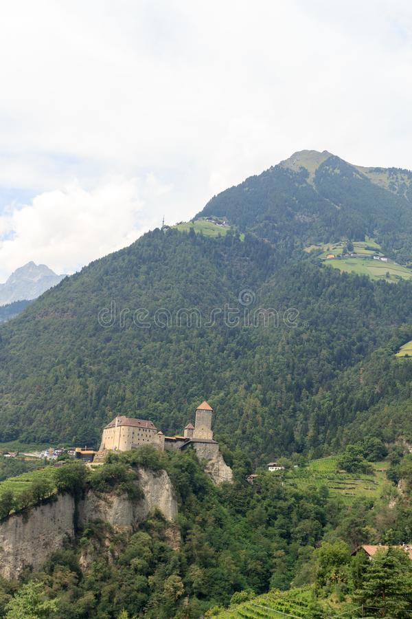 Tyrol Castle and mountain Mutspitze in Tirol, South Tyrol. Italy stock photos
