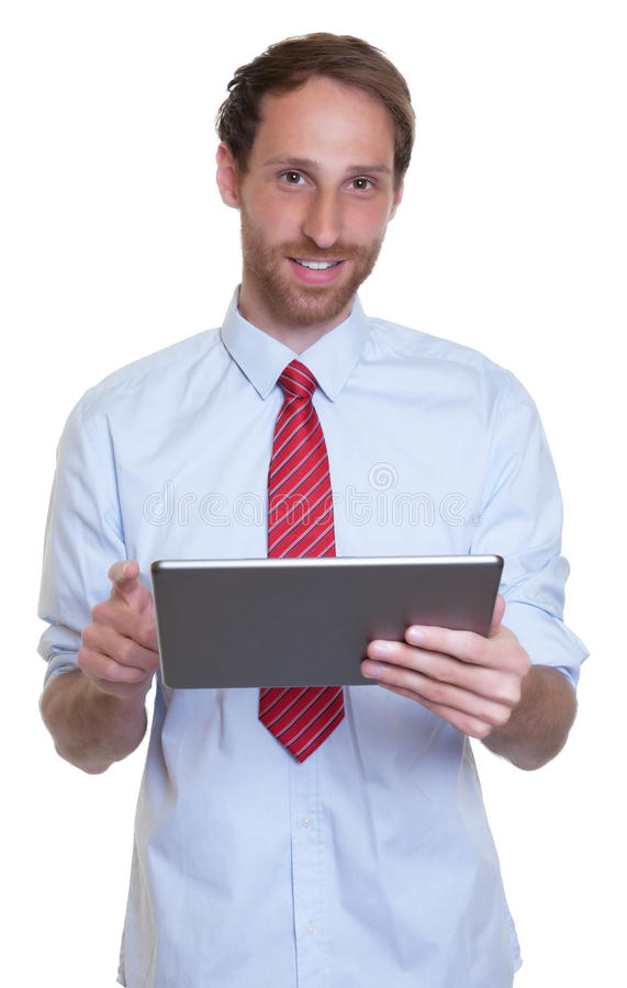 Tysk affärsman med skägg- och minnestavladatoren arkivfoton