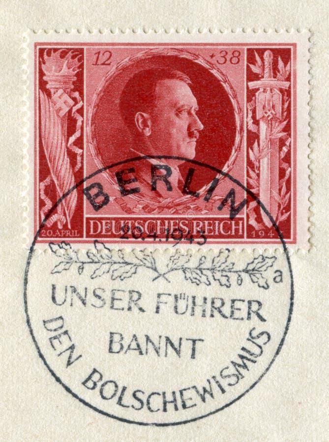 TYSKLAND - CIRCA 1943: Tysk historisk stämpel: '54th födelsedag av Adolf Hitler 'med special annullering 'vår Fuhrer förbudbolshe royaltyfri fotografi