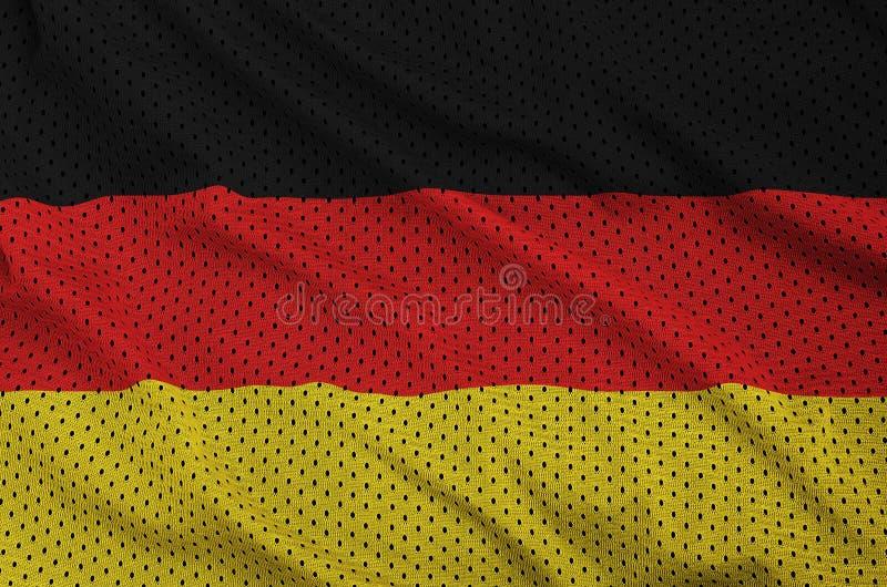Tysklandflaggan skrivev ut på ett tyg för ingrepp för polyesternylonsportswear arkivbilder