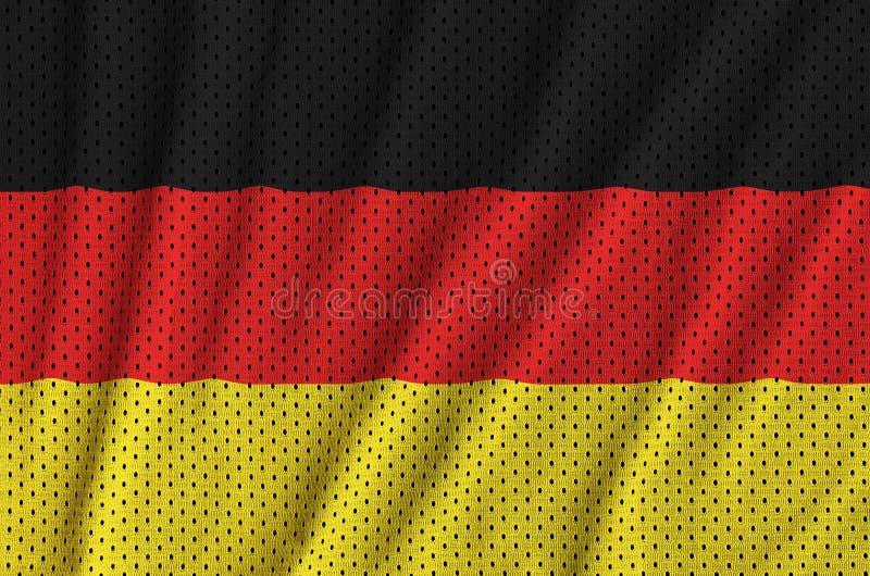 Tysklandflaggan skrivev ut på ett tyg för ingrepp för polyesternylonsportswear royaltyfri foto