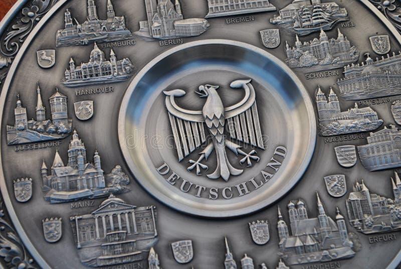 Tyskt emblem på den tenn- epergnen royaltyfri fotografi