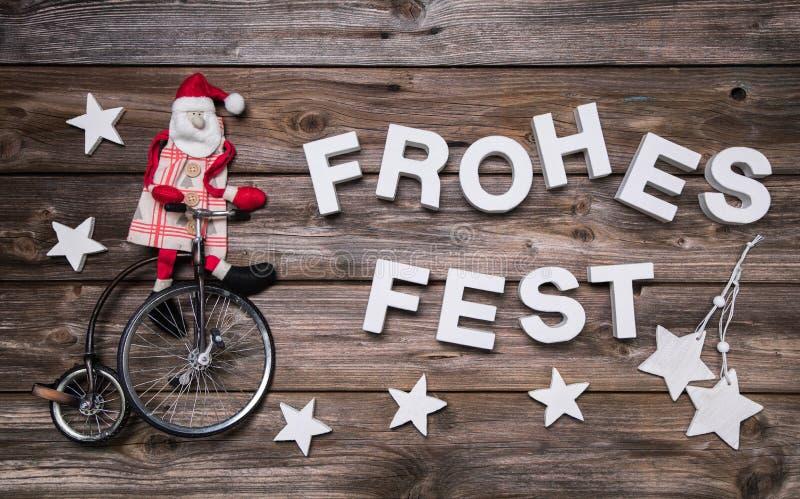 Tyskt julhälsningkort med tysk text xmas för bana för clippinggarnering hjortar isolerad röd arkivfoton