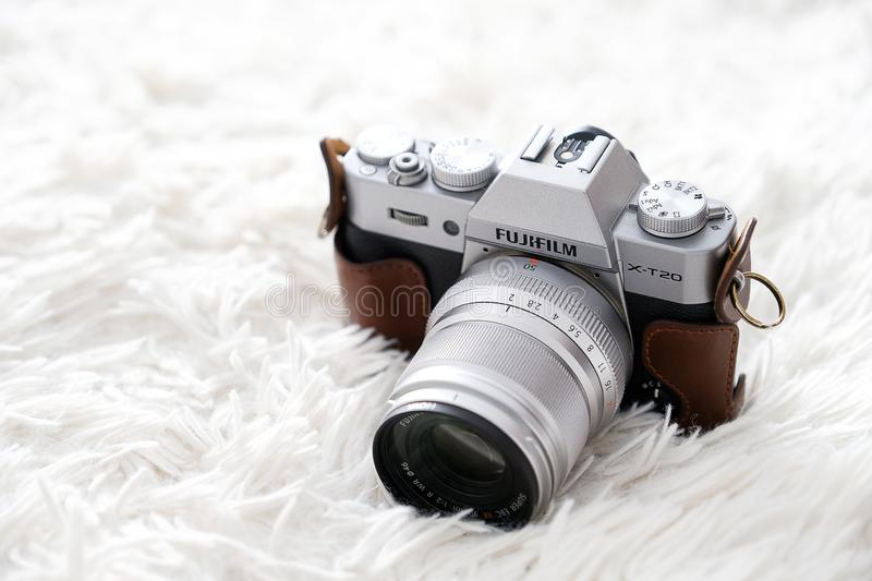 Tyumen, Russia, 09.08.2019. The Fujifilm camera lies on a white blanket. Accessories photographer or freelancer.  royalty free stock images