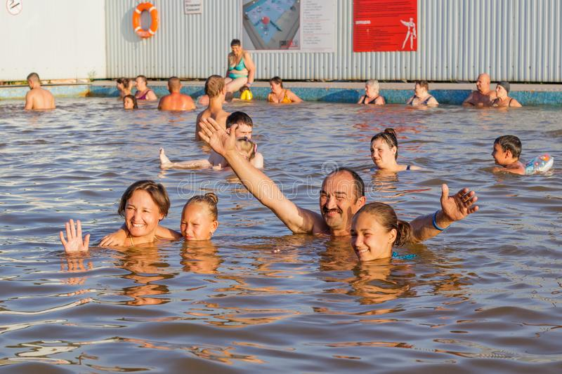 Family takes wellness baths in the thermal pool royalty free stock photography