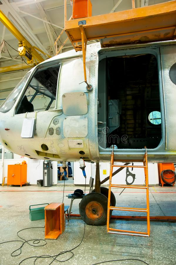 Mi-8 helicopter during maintencance and repair. Tyumen, Russia - June 5, 2019: Aircraft repair helicopter UTair Engineering plant. Mi-8 helicopter during stock image