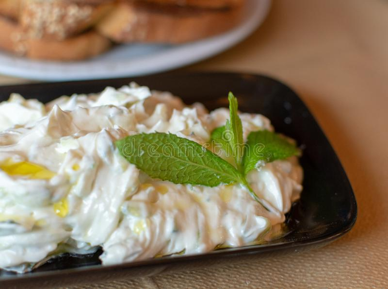 Tzatziki, cacik or tarator,  dip or sauce from Southeast Europe and Middle East made of salted strained yogurt mixed with. Cucumbers, garlic, salt, olive oil stock images